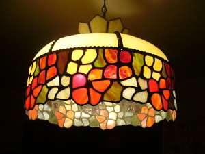 Tiffany style slag leaded glass hanging lamp Cir 1914