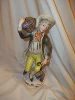 Antique Porcelain Statue Boy basket of grapes