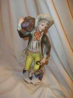 Antique Porcelain Statue Boy basket of grapes