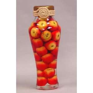 Red Apples in Glass Bottle